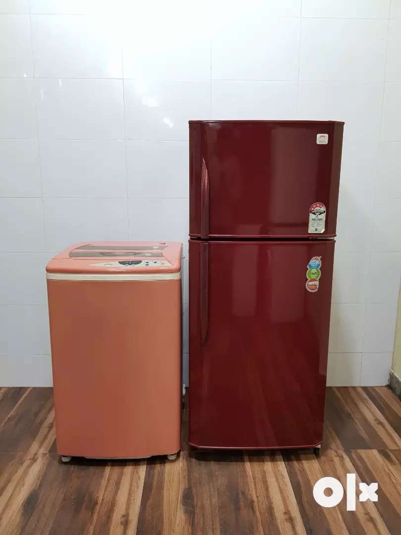Godrej red colour 250 ltrs refrigerator and Samsung washing machine 0