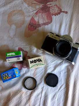 Vintage Pentax K1000 analog film camera in perfect working condition.