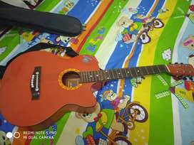 Guitar which is recently purchased is ready for sale.