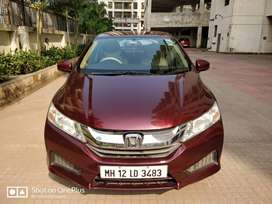 A beautiful wine red colored Honda City Diesel SV Variant