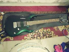 Green Double Cut-away Electric Guitar With Bag and amplifier.