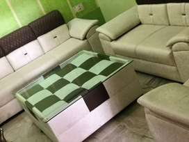 Seven seater sofa with centre table