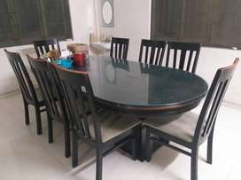 Premium Glass dining Table with 8 chairs.(Negotiable)
