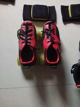 Jonex skates of red and black colour