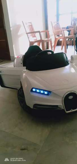 Kids car white colour new condition kids love it very attractive
