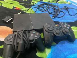 Playstation 2 sony with gaming CDs
