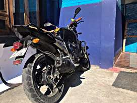 Yamaha FZ with recently changed battery.KN filter extra engine cover