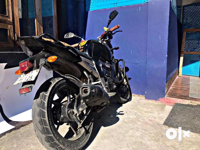 Yamaha FZ with recently changed battery.KN filter extra engine cover 0
