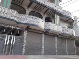 Double story house with shops