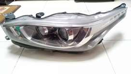 Head lamp yaris 2015 ( kiri )