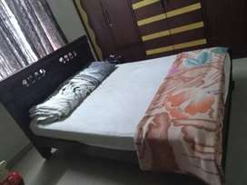 King size bed with couch