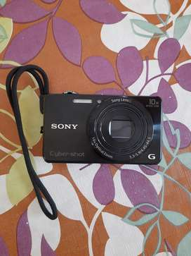 Sony Cybershot DSC-WX220 with 8GB memory card and camera case