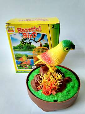 Grosir Mainan Lucu Burung berkicau dalam Sangkar