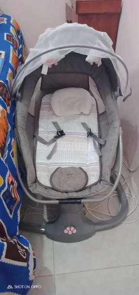 Ayunan bayi elektrik snugli