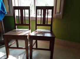 2 chairs made of neem wood.