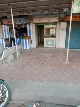 Well furnished shop having she'd and pakki foot path 15 ft wide