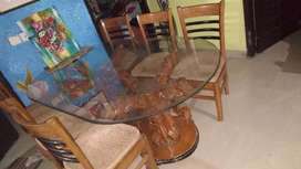 Six seater dining table with glass top