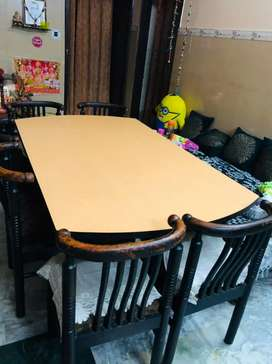 Dinning Table 3.5 feet ×6 feet with six chairs in Good Condition
