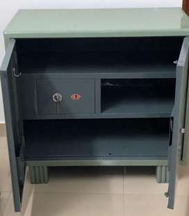 Steel cupboard with inbuilt safe.
