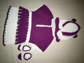 A little girls qureshia frock topi and shoes white and purpel colour