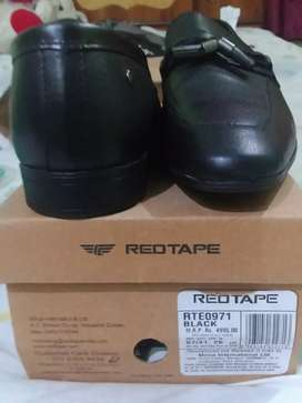 Red tape leather shoe