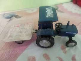 Toy tractor with troli