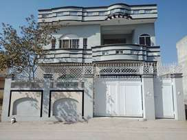 Double story house for sale with two linked streets.