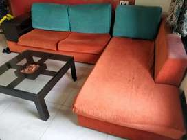 L shaped sofa with wooden side rack