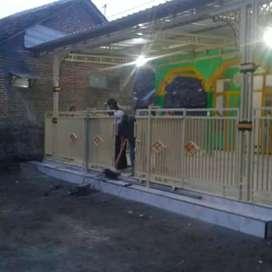 pintu harmonika dan pagar