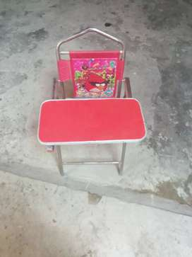 Kids study and dyining chair red clour