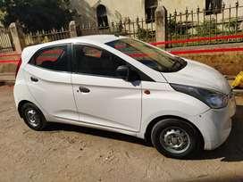 White colour Eon era plus car.