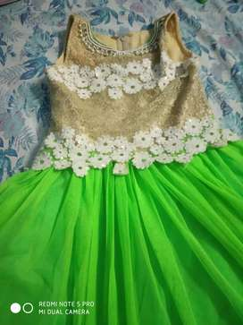Beautiful branded green colour gawn for 6 to 8 year old girl kid