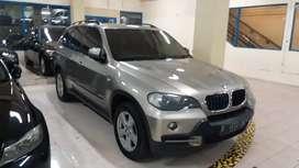 BMW X5 2008 platinum bronze on dark brown