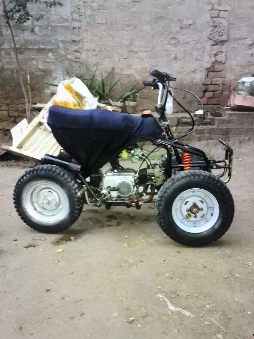 ATV 4 wheelr  simple engine bhi lagwa doo ga jesa kisi ko munasib lage 0