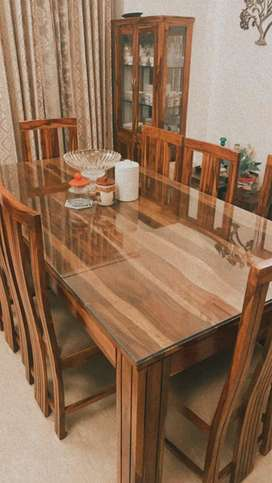 8 seater dining table only one yearold ond in brand new mint condition