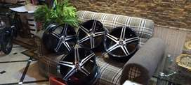 15 inchis allowy rims one month used  jenvion price 25000