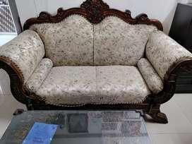 2 seater sofa and glass centre table