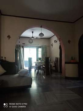 3BHK ventilated apartment facing road & greenery with two balconies.
