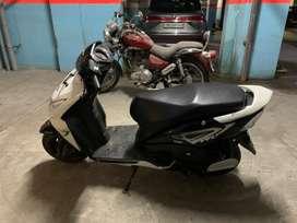 Black and White 2015 model Honda DIO