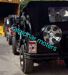 Modified black Willy's jeeps