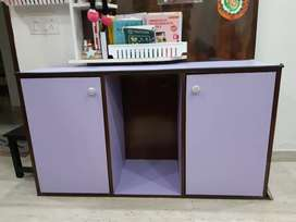 Kids 2 door cabinet cum study table with chair space to slide in