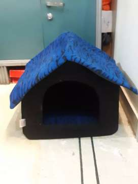 A pet house for cats or small sized dogs.