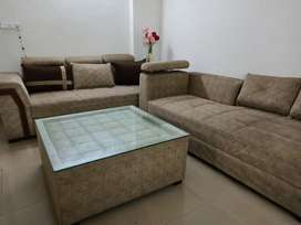 L shaped sofa with 5 cushions 2 Puffies and center Table