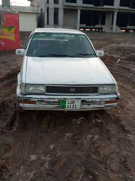 Car 86 Corolla white colour best condition Lahore number