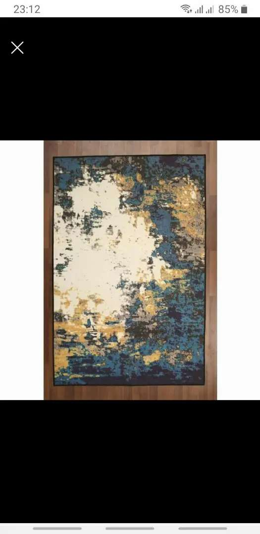New trendy carpet .. beautiful shades of blue and gold.