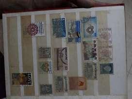 Perangko antik dari berbagai negara dan uang lembar 1000 antik