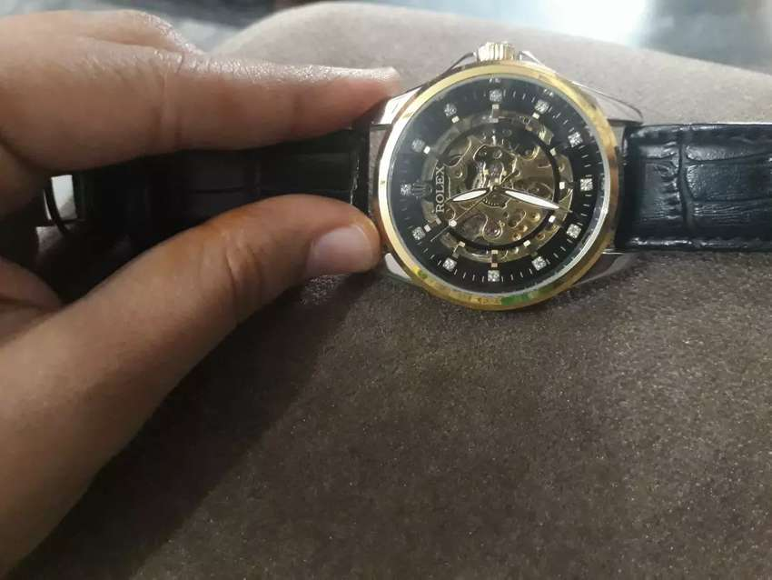 Black and golden watch 0