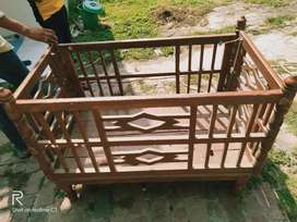 caradil  baby   one year old. wooden
