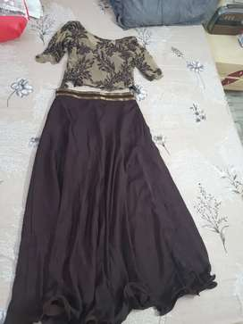 Brown and golden crop top and skirt