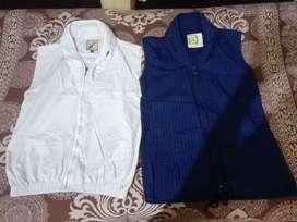 2 Sleeveless jackets blue and white